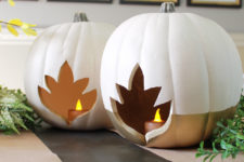 DIY faux pumpkin candle holders with maple leaf cutouts