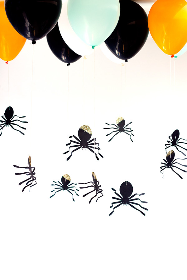 DIY glitter spiders hanging on balloons (via studiodiy.com)