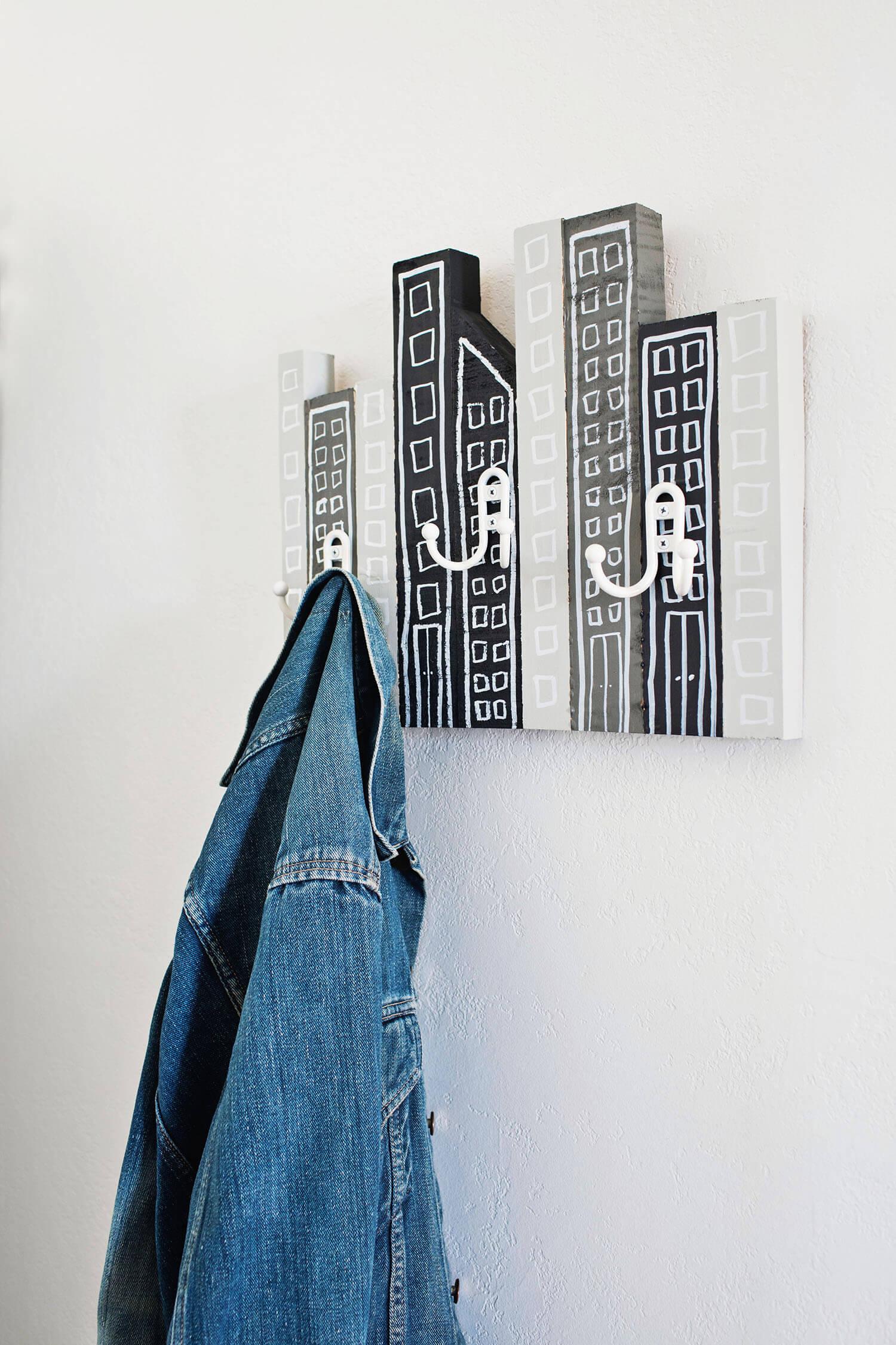 DIY cityscape coat rack of scrap wood