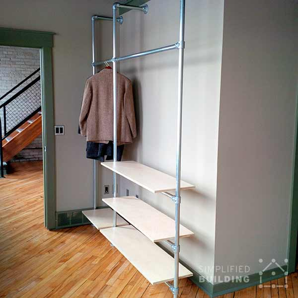DIY modern wood and pipe coat rack  (via www.simplifiedbuilding.com)