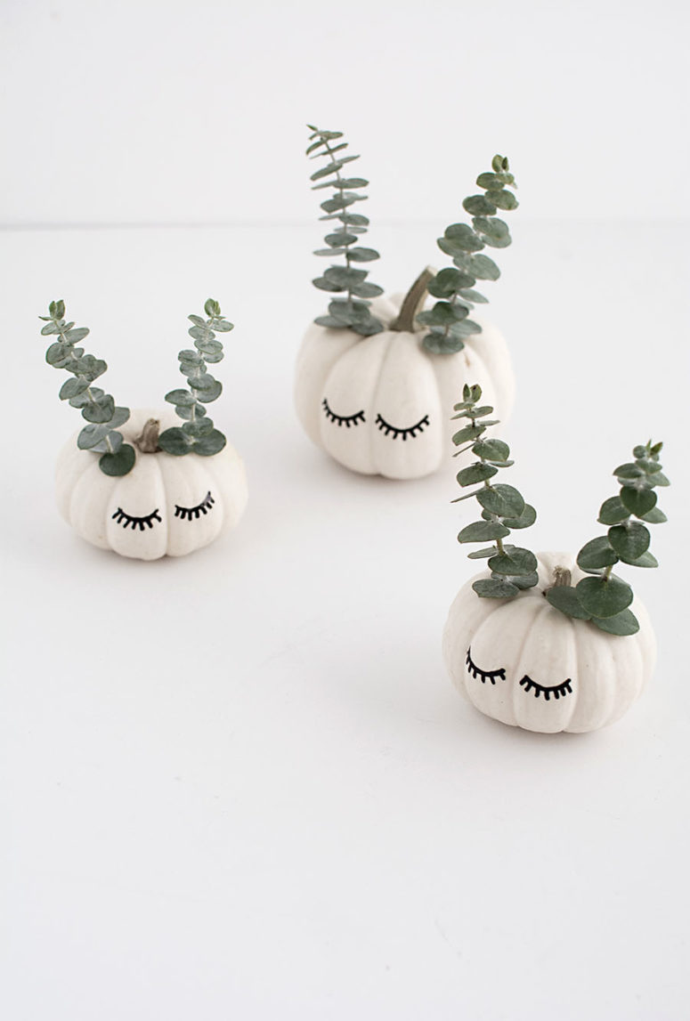DIY cute faced pumpkins with eucalyptus (via www.homeyohmy.com)