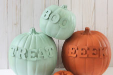 DIY muted color painted pumpkins with letters