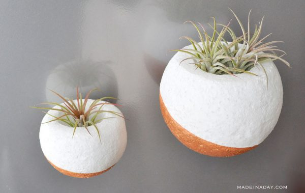 DIY faux concrete planters of foam balls (via madeinaday.com)