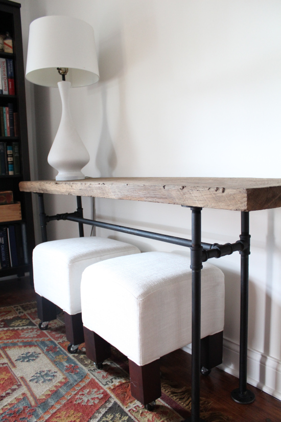 DIY industrial black pipe and wood console table (via handmaidtales.com)