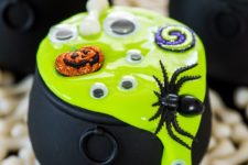 DIY mini cauldrons with slime, spiders and googly eyes as party favors