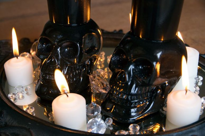 DIY skull votive holders in black for Halloween (via erynwithay.typepad.com)