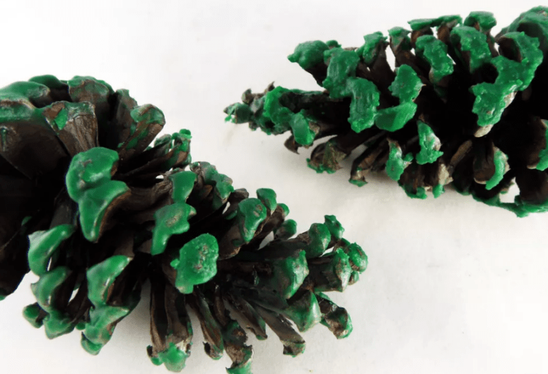 DIY pinecone firestarters with bright green touches (via thesprucecrafts)