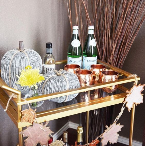 a simple bar cart with a glitter leaf banner, fabric pumpkins and copper mugs for Thanksgiving