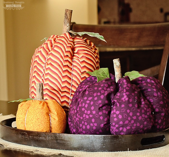 DIY colorful fabric pumpkins with wood stems (via www.scatteredthoughtsofacraftymom.com)