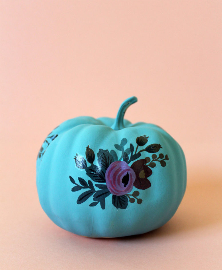 DIY vibrant floral pumpkin with tattoos (via kraftmint.com)