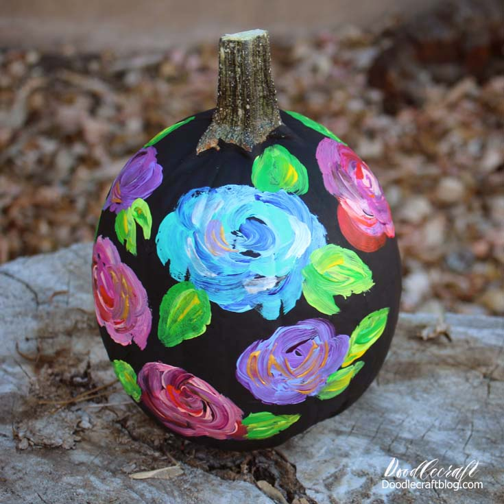 DIY black pumpkin with bright painted flowers (via www.doodlecraftblog.com)