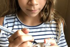 DIY kids' ornament with white bulbs and sharpies