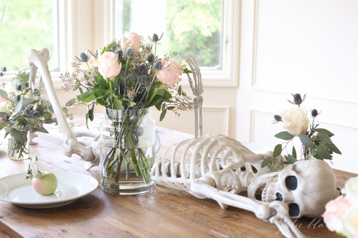 DIY natural Halloween tablescape with a skeleton centerpiece (via julieblanner.com)