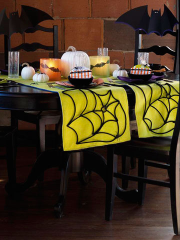 DIY neon spiderweb Halloween table runner (via www.shelterness.com)