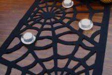 DIY cutout black spiderweb table runner of felt