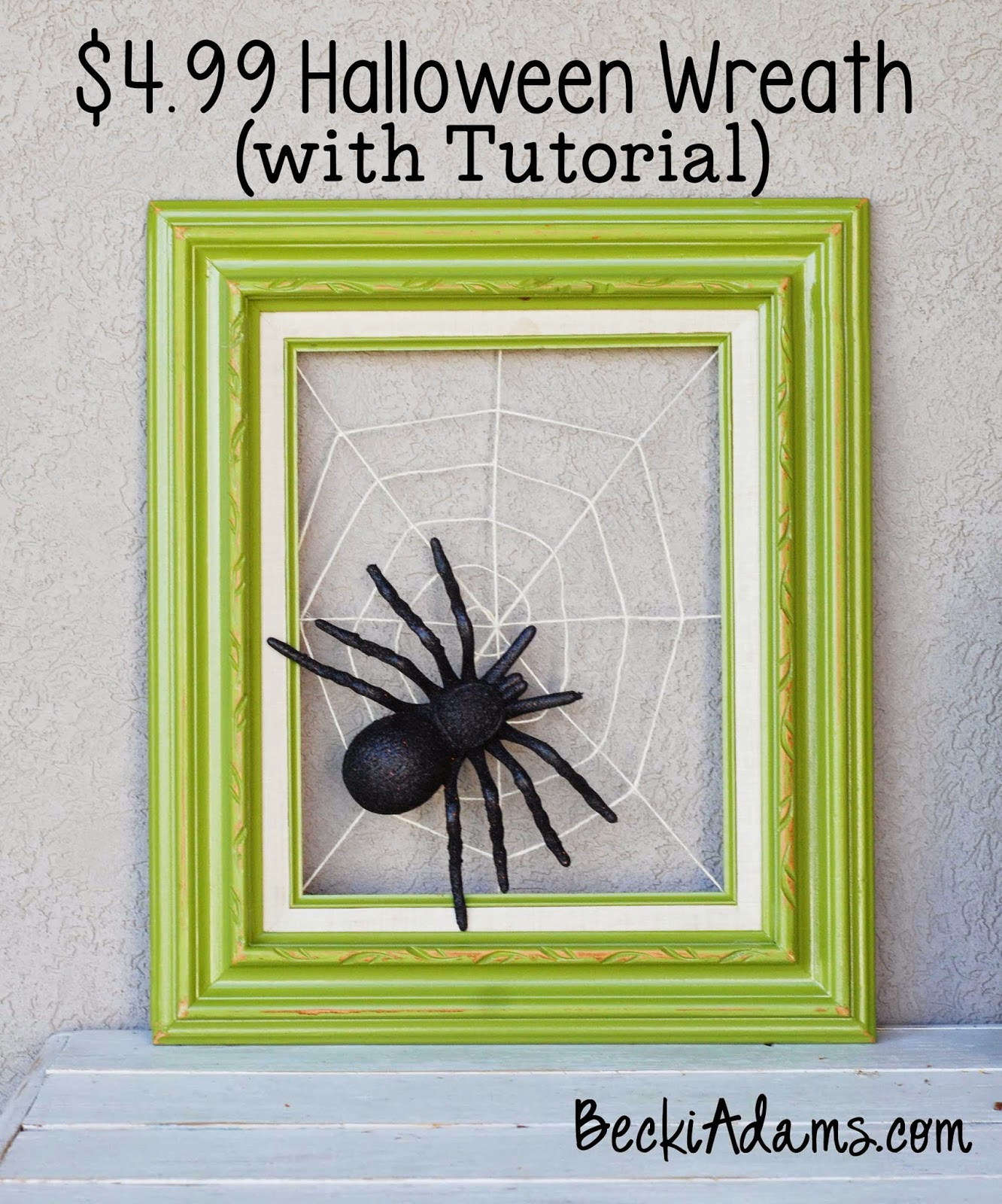 DIY Halloween wreath or artwork of a neon frame and spiderweb with a spider