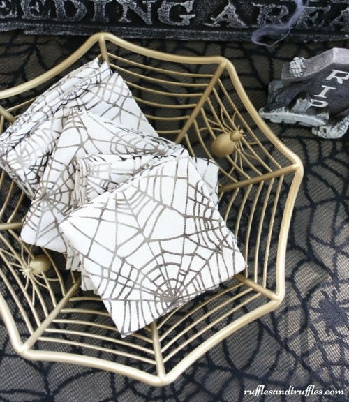 DIY gold spiderweb bowl with spiders for Halloween (via www.shelterness.com)