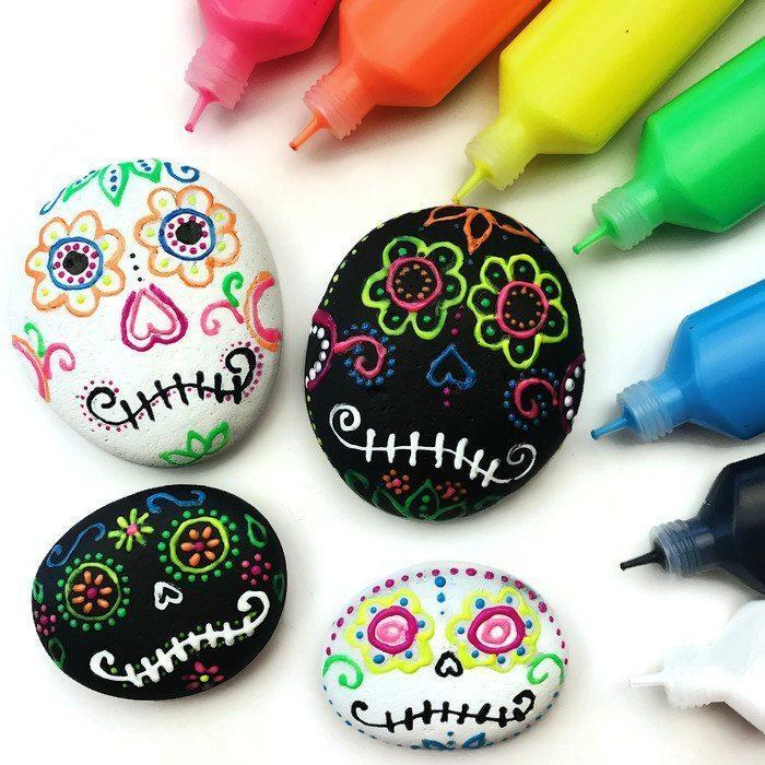 DIY sugar skull rocks with puffy paints (via colormadehappy.com)
