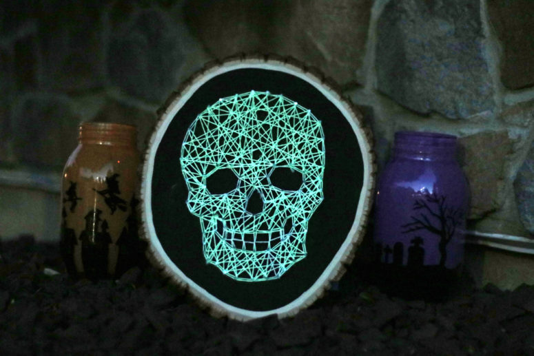 DIY glowing skull string art craft for Halloween (via www.wholesalepartysupplies.com)