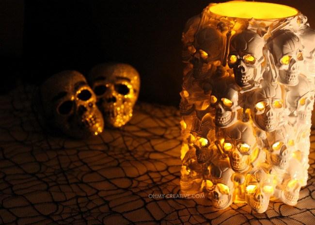 DIY boneyard lantern of plastic skulls (via www.ohmy-creative.com)