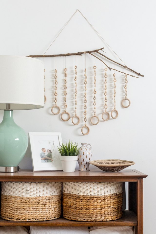 DIY boho wall hanging of branches and wooden rings