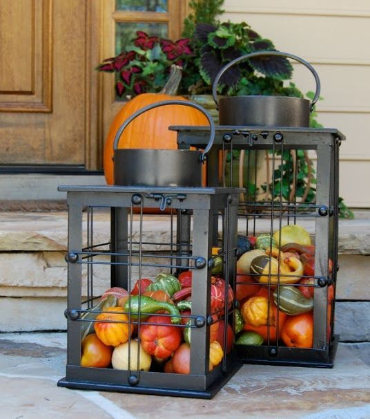 metal lanterns filled with real veggies is a cool idea for Thanksgiving, harvest is symbolic