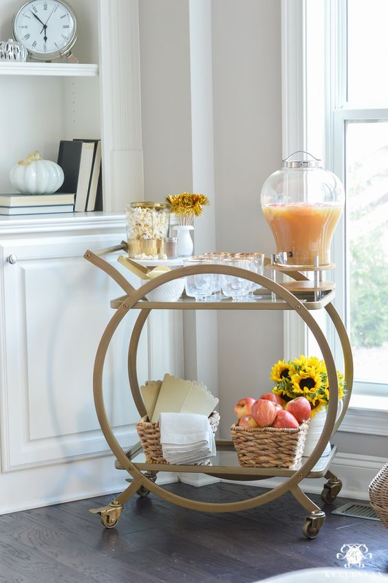 sometimes all you need for styling a bar cart is some apples in a basket and a bright sunflower arrangement