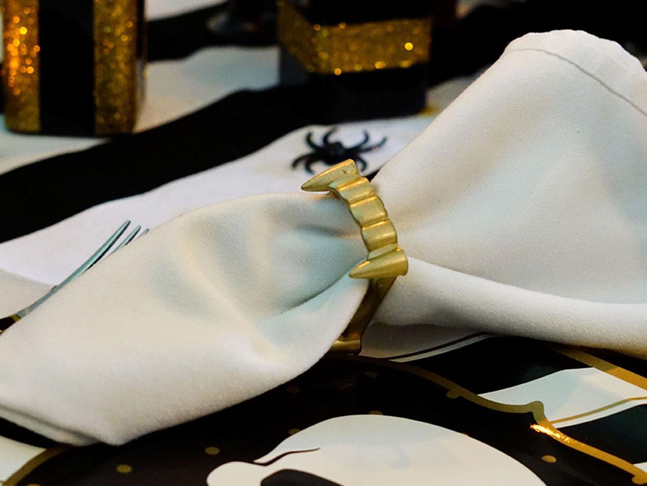DIY gilded vampire fangs napkin rings for Halloween