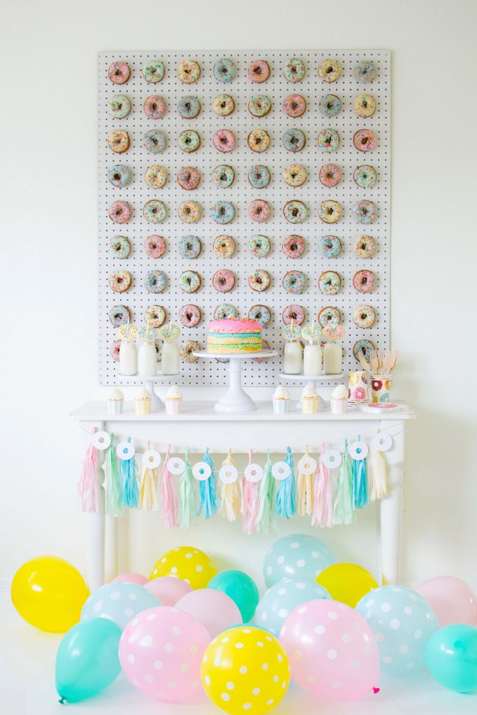DIY pegboard donut wall for a colorful dessert table (via twinkletwinklelittleparty.com)