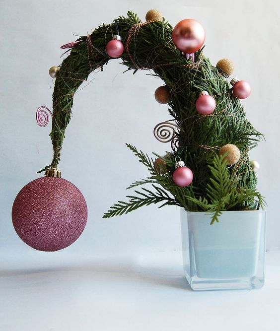 a tabletop Grinch christmas tree with pink and gold glitter ornments is a fun idea