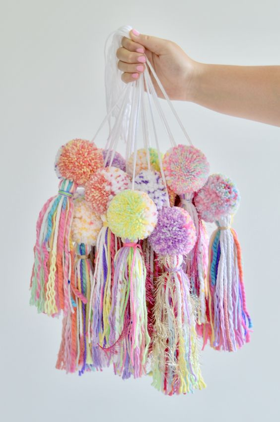 make your tree bright and bold with colorful pompom and tassel ornaments, all made for cheap