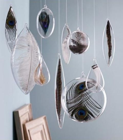 clear ornaments of various shapes filled with feathers of different kinds