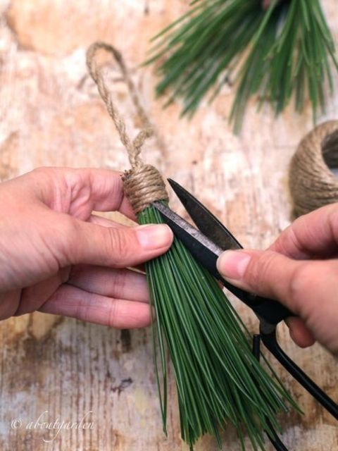 make tassels of real pine needles and twine, this is a such a cool natural idea that will easily bring a natural feel to your home