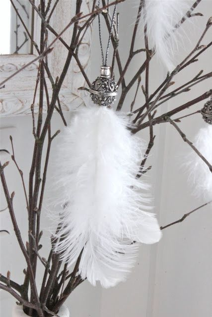 Christmas feather ornaments with beautiful silver beads on top will give your tree an airy look