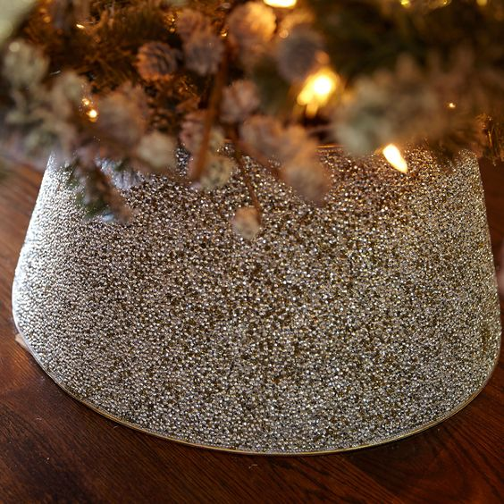toast to a holiday season with plenty of shimmer and shine, add a dazzling beaded tree collar to make the tree stand out