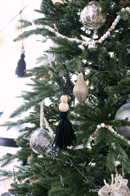 a black tassel and wooden bead Christmas tree ornaments are amazing for a touch of boho style