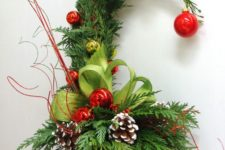 07 a bright Grinch-inspired Christmas tree of ferns, yellow and red ornaments, snowy pinecones and plaid