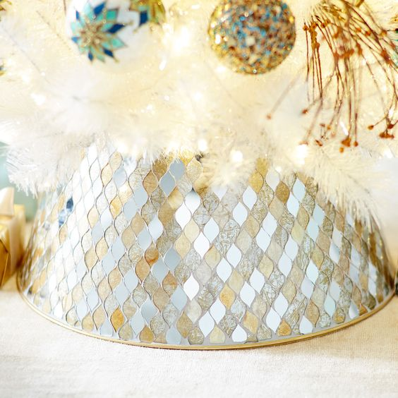make your tree shimmering with this handcrafted tree collar featuring hand-laid mirrors in gold and silver tones
