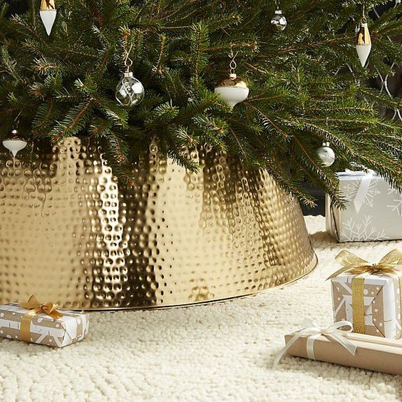 a glam bash gold tree collar will raise your Christmas tree decor to a new level