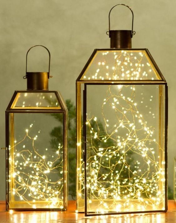 a duo of lanterns with LEDs inside is a simple modern idea for Christmas, great as a last-minute craft