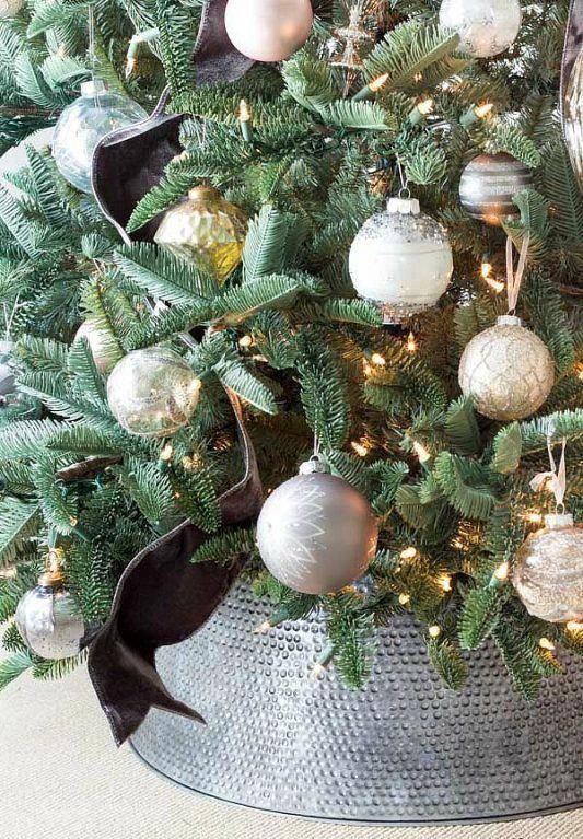 a bashed metal Christmas tree skirt is a great touch to a rustic or metallic Christmas tree