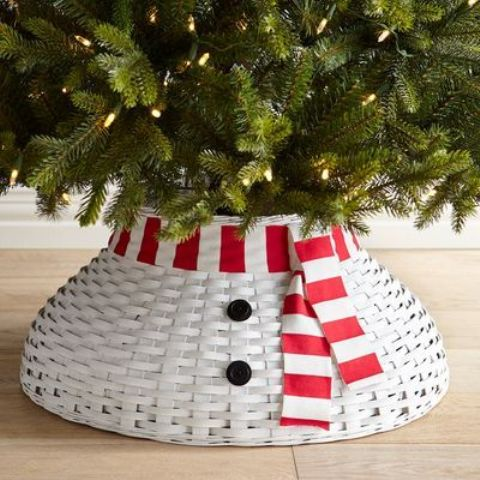 a basket snowman tree collar with buttons and a striped scarf for a fun touch