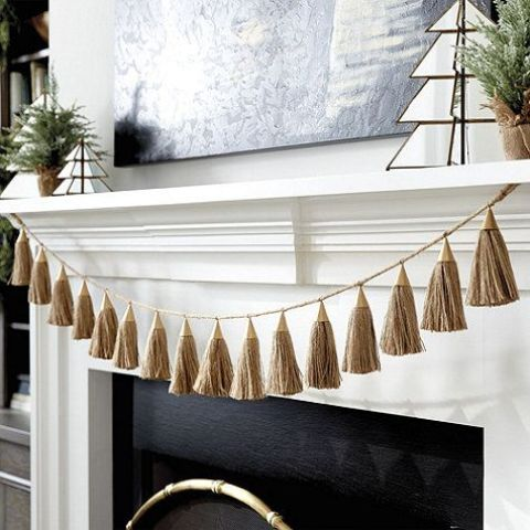 an elegant Christmas garland of tassels in gold is a chic way to decorate for winter holidays