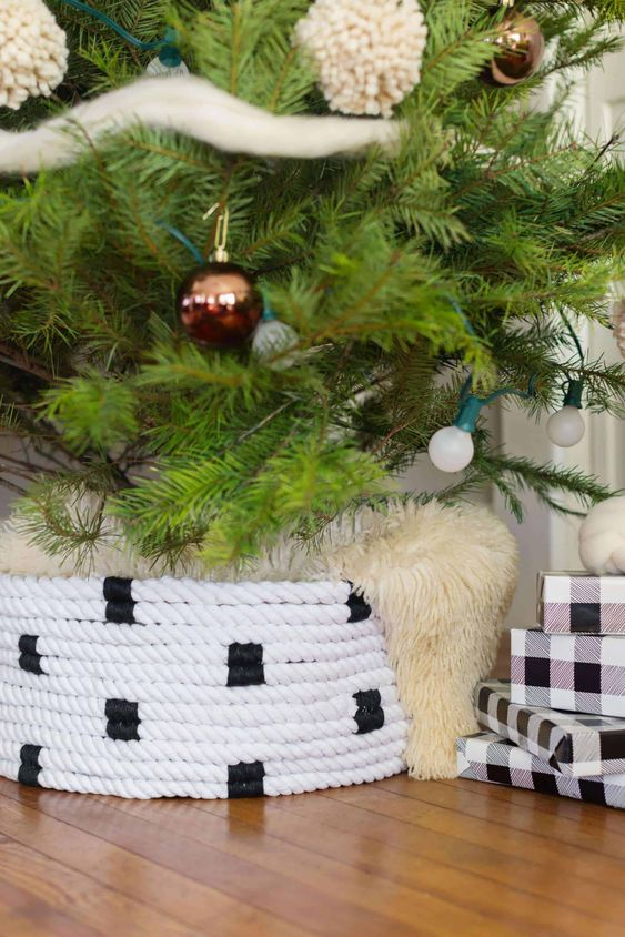 a black and white rope Christmas tree collar covered with faux fur