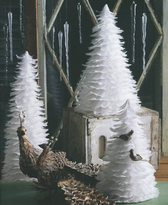 a trio of white feather Christmas trees is a cool idea for your mantel or windowsills