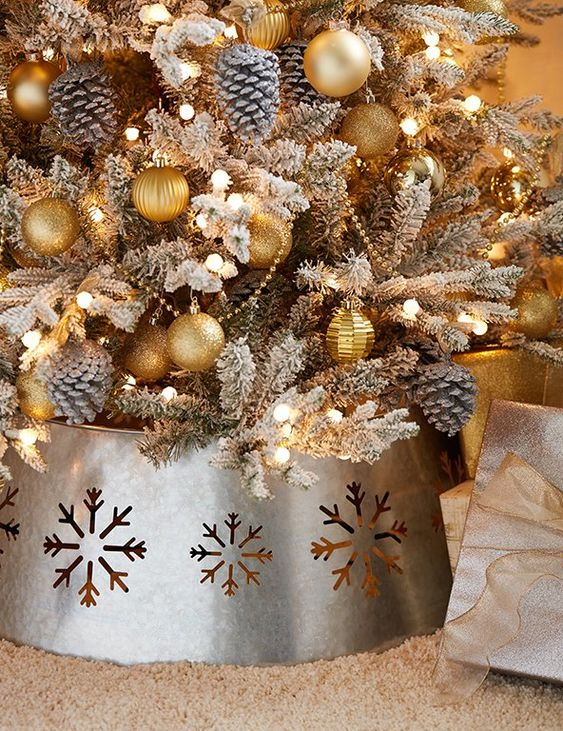 a galvanized metal tree collar with laser cut snowflakes is a great finishing touch for your tree