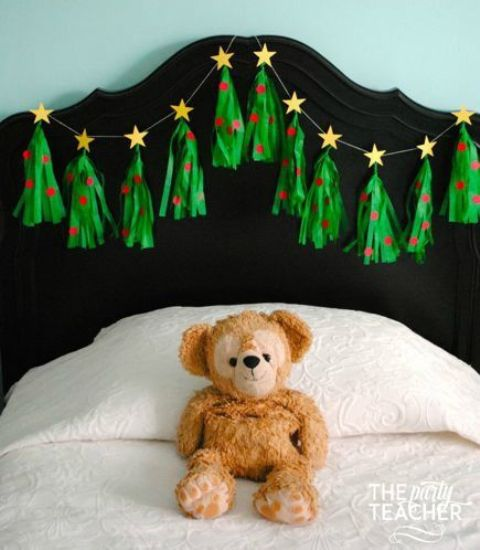 green and red tassels with stars on top make up a cool Christmas tree garland for a kids' room