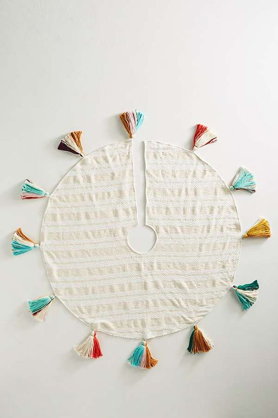 a striped tree skirt with super colorful tassels is all you need for fun retro or boho chic decor