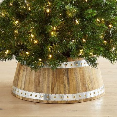 a wood and galvanized metal tree collar is a cool idea for traditional and rustic tree decor