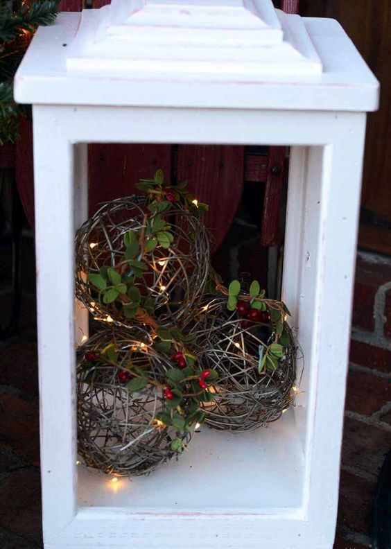 an outdoor lantern with vine balls, berries, foliage and LEDs for your porch and stairs